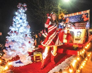 Megan Sealy waves as she rides on the Kizer Flooring float during the Oxford Christmas Parade in Oxford, Miss., on Monday, December 7, 2015.