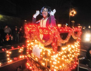 Destiny Lynch rides on the Jeffrie Chapel Missionary Baptist Church float during the Oxford Christmas Parade in Oxford, Miss., on Monday, December 7, 2015.