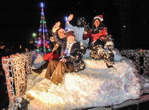 The North Mississippi Regional Center float makes its way along North Lamar during the Oxford Christmas Parade in Oxford, Miss., on Monday, December 7, 2015.