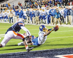 Bruce Newman Oxford's DK Metclaf (14) is stopped just short of the goal line as time expires by Wayne County's ZaBryon Jackson (11) in the MHSAA Class 5A championship game at Vaught-Hemingway Stadium on Saturday. The Chargers, playing in their third straight state finals, fell 45-41 to the War Eagles.