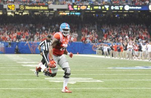 Ole Miss offensive lineman Laremy Tunsil (78) runs for a 2 yard touchdown against Oklahoma State in the Sugar Bowl at the Mercedes-Benz Superdome in New Orleans, La. on Friday, January 1, 2016. (AP Photo/Oxford Eagle, Bruce Newman)
