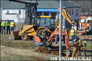 CenterPoint Energy workers repair a gas line on West Jackson Avenue in Oxford, Miss. on Thursday, February 11, 2016.