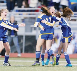 Morgan O'Connor (11) is congratulated by teammates after scoring the game-winning goal against West Harrison. (Keith Warren).