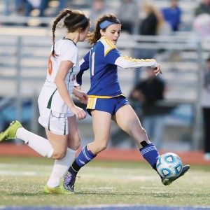 Morgan O'Connor scores the goal that gives Oxford the 2-1 lead late in the match against West Harrison. (Keith Warren)