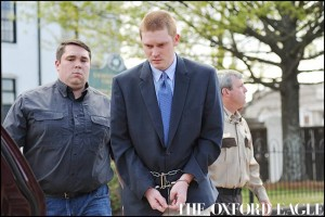 Derrick Boone is escorted from the Lafayette County Courthouse in Oxford, Miss. on Thursday, April 7, 2016. Boone pleaded guilty to a murder charge in the death of Zacharias Hercules McClendon. Boone was sentenced to life without parole.