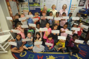 Oxford Elementary students, with Daughters of the American Revolution members, back, from left, Laurie Triplett, Gail Hercules, and Sally Malone, hold letters the class has written to U.S. soldiers, in Oxford, Miss. on Wednesday, May 11, 2016. The DAR is attempting to set a Guinness World Record for number of letters sent to active duty service members in one month's time.