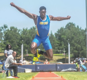 Oxford's D.K. Metcalf competes in the triple jump Saturday. Metcalf placed second in the event.