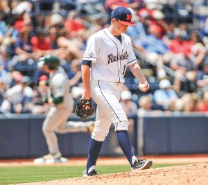 Ole Miss pitcher David Parkinson (10) walks back to the mound after giving up a second home run to Tulane first baseman Hunter Williams. (Bruce Newman)