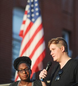 LaToya Faulk, left, and Rachel Johnson speak during a peaceful protest and candlelight vigil in Oxford, Miss. on Saturday, July 16, 2016.The event was held to mourn recent violence, including police shootings of African American men and the killing of five police officers in Dallas. (Bruce Newman, Oxford Eagle via AP)