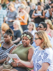 People sing during a peaceful protest and candlelight vigil in Oxford, Miss. on Saturday, July 16, 2016. The event was held to mourn recent violence, including police shootings of African American men and the killing of five police officers in Dallas. (Bruce Newman, Oxford Eagle via AP)