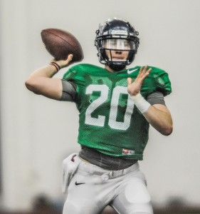 Highly touted freshman Shea Patterson (20) could be too talented to keep off the field completely this season. (Bruce Newman)