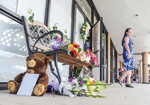 Bruce Newman Flowers are placed at the door to the Farese Family Dental office Monday. Dentists Dr. Jason Farese and his wife Dr. Lea Farese, Dr. Austin Poole and his wife Angie Poole, and Dr. Michael Perry and his wife Kim Perry were killed in a plane crash outside Tuscaloosa, Ala., Sunday.