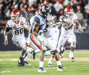 Arkansas running back Alex Collins (3) runs for a first down on a fourth and 25 play in overtime at Vaught-Hemingway Stadium in Oxford, Miss. on Saturday, November 6, 2015. (Bruce Newman)