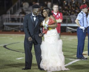 Gabrielle Dunn reacts with Keidrian Buford after being named 2016 Lafayette High School homecoming queen at halftime of the game between Lafayette and Rosa Fort in Oxford, Miss., Thursday, Oct. 6, 2016. (Photo/Thomas Graning)