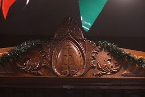 The bar at Fat Eddie's Lamar Lounge has the initials of its previous owner, Eddie Fisher.