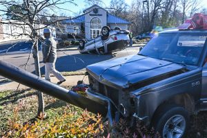 A vehicle sits overturned on University Avenue near South 16th Street in Oxford, Miss. on Friday, December 30, 2016.
