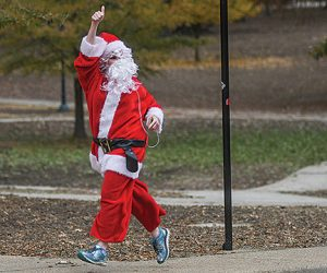 Alice Kelly Morgan runs dressed as Santa Claus near the Grove, in Oxford, Miss. on Sunday, December 11, 2016.