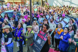 Participants in the Women's March for America listen to a speaker, in Oxford, Miss. on Saturday, January 21, 2017.